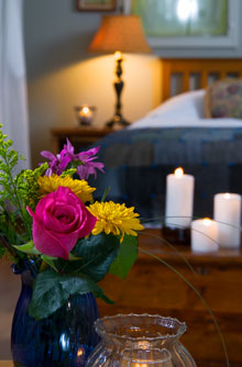 Photo bouquet and candles in hotel room